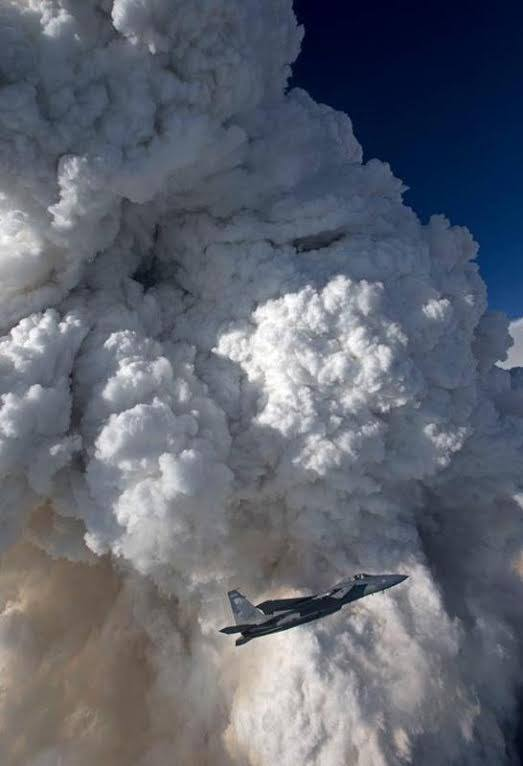 """An F-15 Eagles from the 173rd Fighter Wing, Oregon Air National in the foreground of a pyroCb produced from the Oregon Gulch Fire. (Photo Credit: Jim """"Hazy"""" Haseltine, HIGH-G Productions)"""